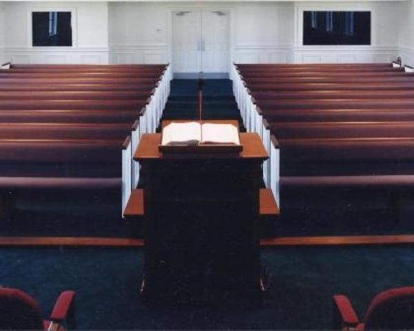 Upholstered church pews with custom ends as seen from the pulpit.